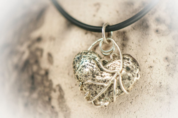 Beautiful cast pendant with a handmade chain.